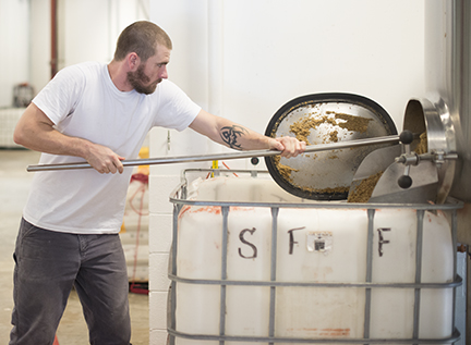 Brewer Noah Cowles was greeted with an abundance of spent grain when he opened the door of the mash tun.